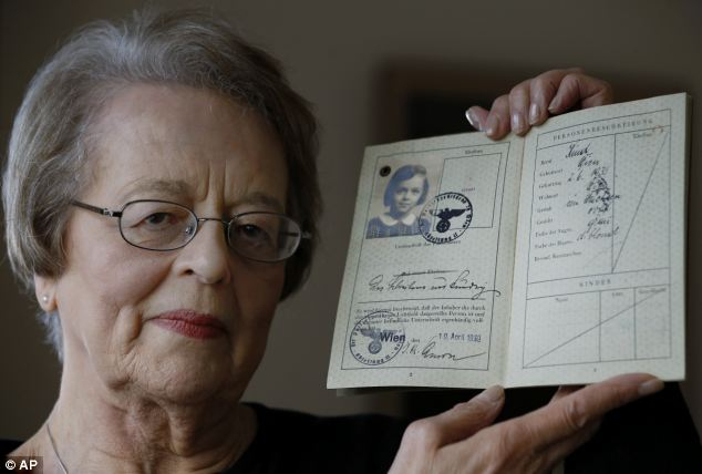 Eve Willman, 80, holds a copy of her 1939 passport at her home in London. She was brought to England from Vienna at the age of five in April 1939