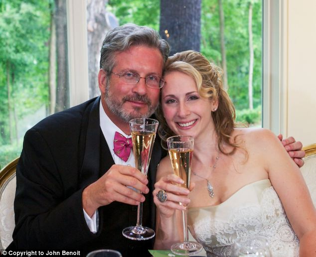 Happy: The couple (at their wedding last year) met when she offered to take photos for his foundation