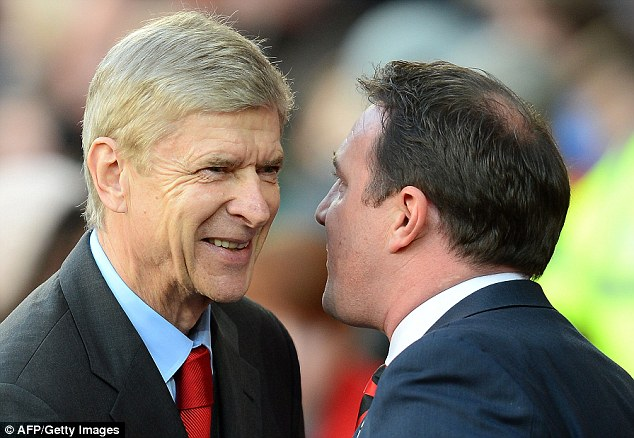Ignore them: Wenger insists the television pundit's doubts are merely an opinion