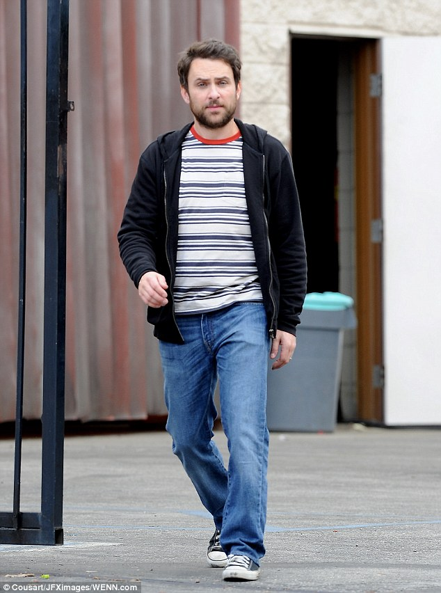 Walking tall: Charlie Day looked deep in thought as he strolled around the set in casual clothing