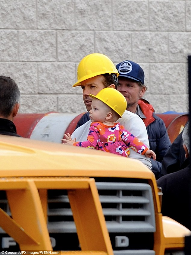 Mini-me: Jason and the tot looked adorable in matching hard hats on set