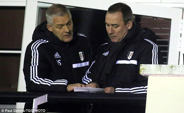 Watching brief: Rene Meulensteen watches the Under 21s with goalkeeping coach Hans Segers on Monday night