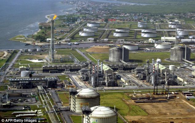 Aid: Oil-rich Nigeria, which is mired in corruption, will receive £1.14billion in foreign aid from Britain over the five years of the Coalition. Above, the Total Nigeria onshore oil and gas refinery at Amenam in the delta of the Niger River in Nigeria.