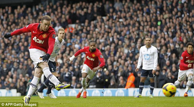 Manchester United's Wayne Rooney scores his second goal from the penalty spot against Tottenham on Sunday