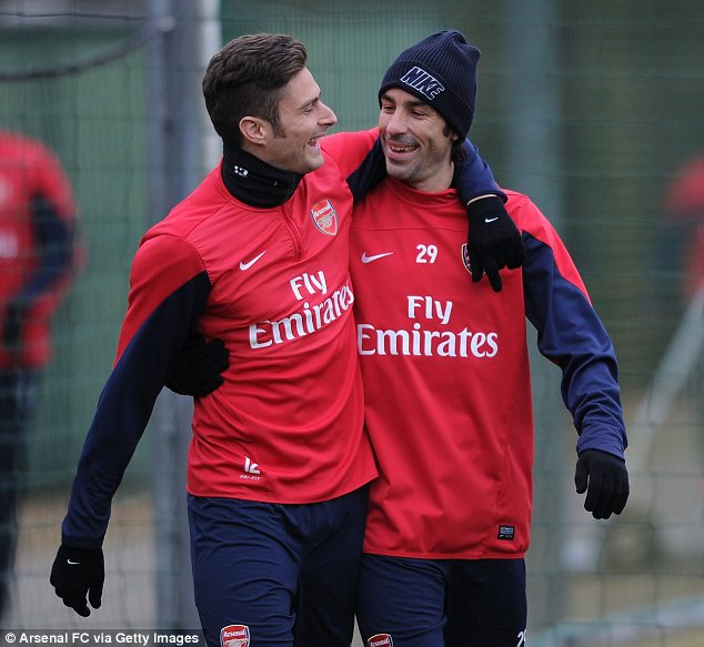 French connection: Arsenal's Olivier Giroud jokes with Robert Pires