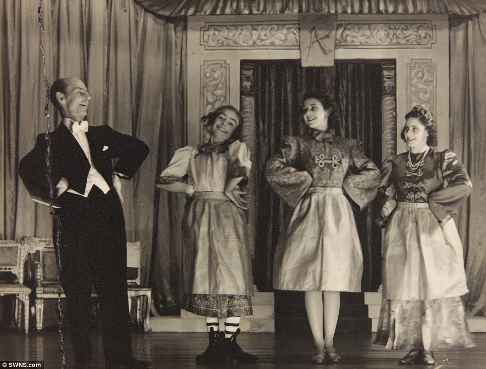 A signed photograph of Princess Margaret (right) and Princess Elizabeth (second from right) in the play Aladdin, 1943, at the Royal School, Windsor