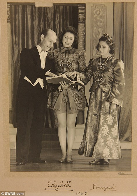 A signed photograph of Princess Margaret (right) and Princess Elizabeth (left) in the play Aladdin