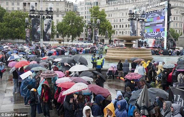 Dedicated: Fans waiting in the rain in Trafalgar Square for the Harry Potter film premiere