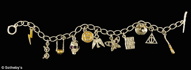 The bracelet features 12 charms, 11 of which depict a significant image from the magical world of the Harry Potter series, including Harry's scar (far left) and a wand (far right)