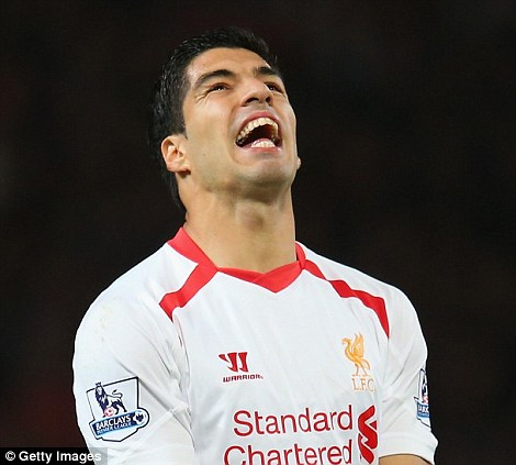 Famed: Luis Suarez is cast as the shark in the Animal XI after digging his teeth into Branislav Ivanovic last season