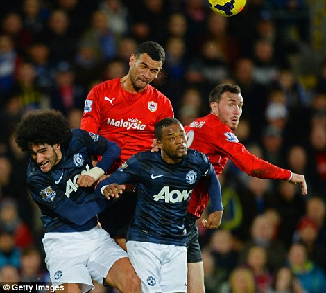 Giant leap: Steven Caulker has shown his aerial prowess for Cardiff this season