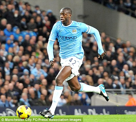 On the charge: Yaya Toure has dazzled in midfield for Manchester City with his powerful displays