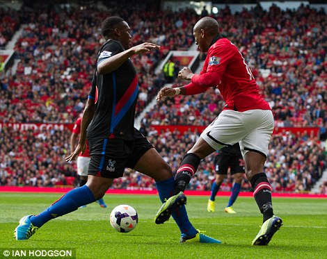 Cheeky: Ashley Young has been branded a cheat by some for hitting the deck too easily in the penalty box
