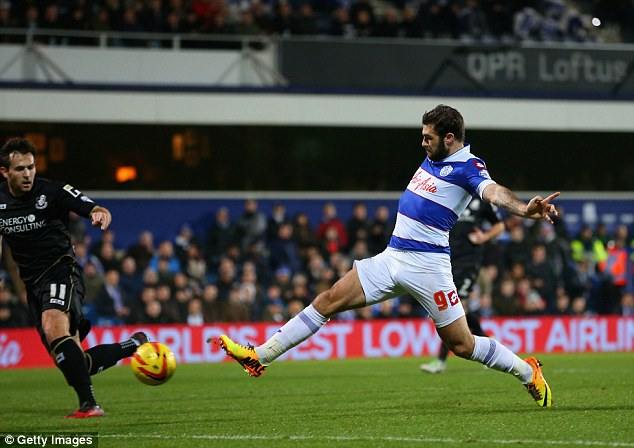 Slotted: Austin pokes through a striker's finish to put QPR 1-0 up against Bournemouth at Loftus Road