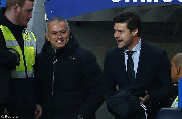 Sharing a moment: Chelsea manager Jose Mourinho (left) and his Southampton counterpart Mauricio Pochettino share a joke at Stamford Bridge
