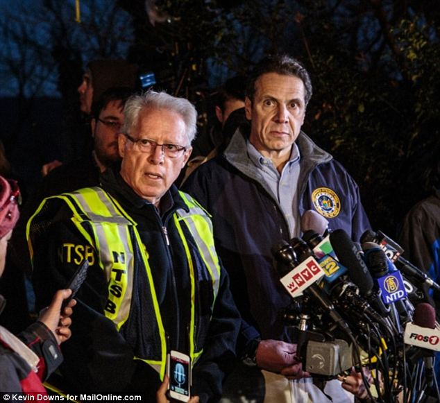 Critical: Governor Cuomo, seen at the crash site on Sunday alongside NTSB's Weener, has now said that the engineer will undoubtedly be punished for the 'unjustifiable' speed as he was going 82mph in a 30mph zone