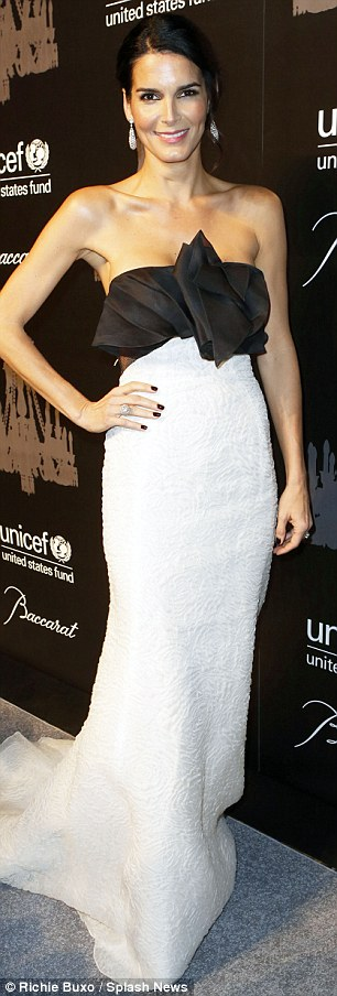 Flawless: Angie Harmon showed off her slender figure in a white-and-black strapless gown that featured ruching at the bust