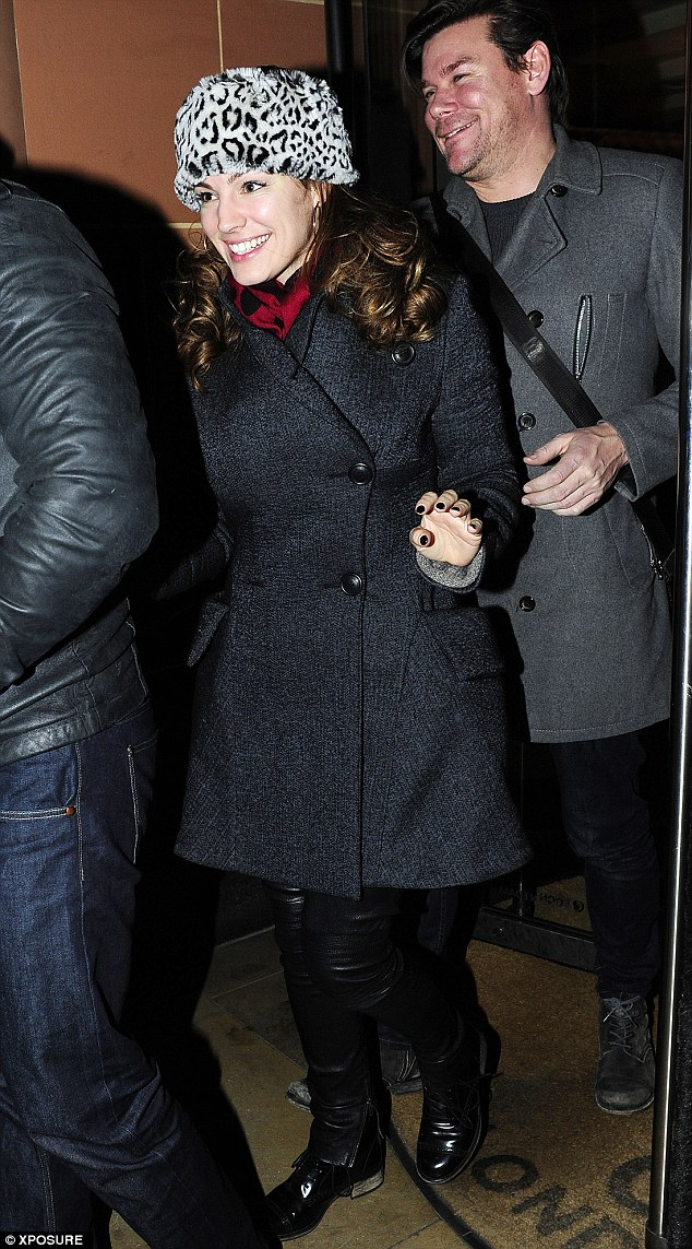 Wrapped up: Kelly Brook looked warm as she left the C London restaurant on Tuesday