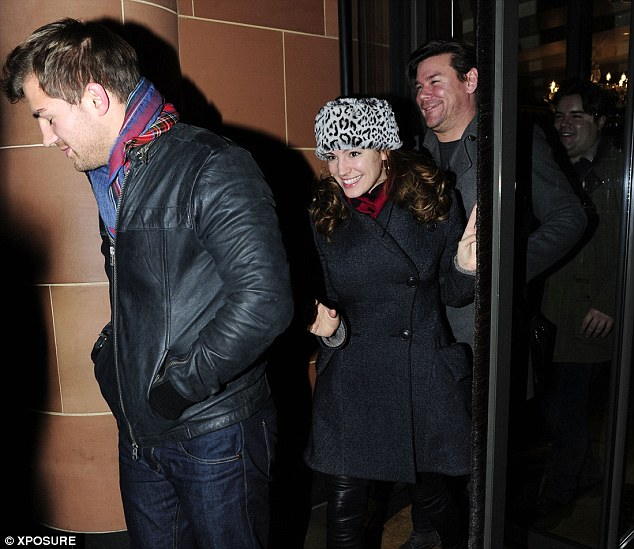 Not one, but three: Kelly was joined by three men as she dined out in London - one of whom is TV presenter Phil Turner