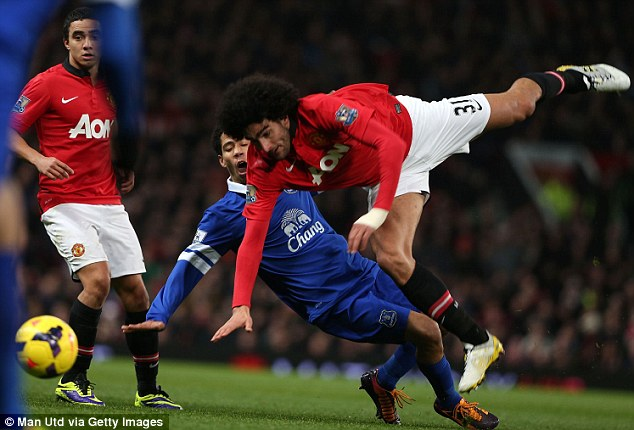 Challenge: Marouane Fellaini failed to shine in Manchester United's disappointing defeat against Everton