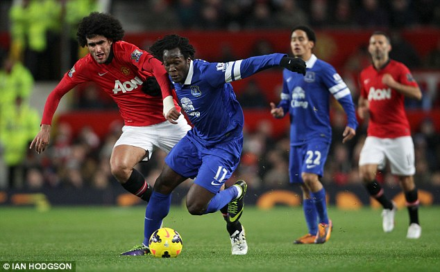Get out of my way: Romelu Lukaku barges into Fellaini before charging towards the penalty area