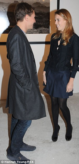 Date night: Beatrice enjoyed a hug with her boyfriend Dave Clark at the event