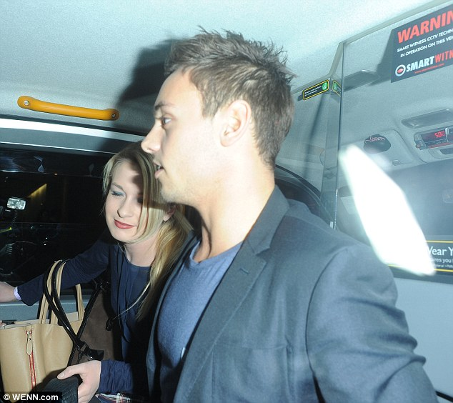 Taxi! Tom travelled home in style after enjoying a family night out
