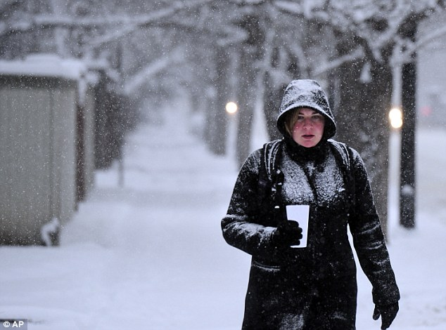 Brittany Katalenas braves snowy conditions on her walk to work in Boulder, Colorado as sub-zero temperatures set in