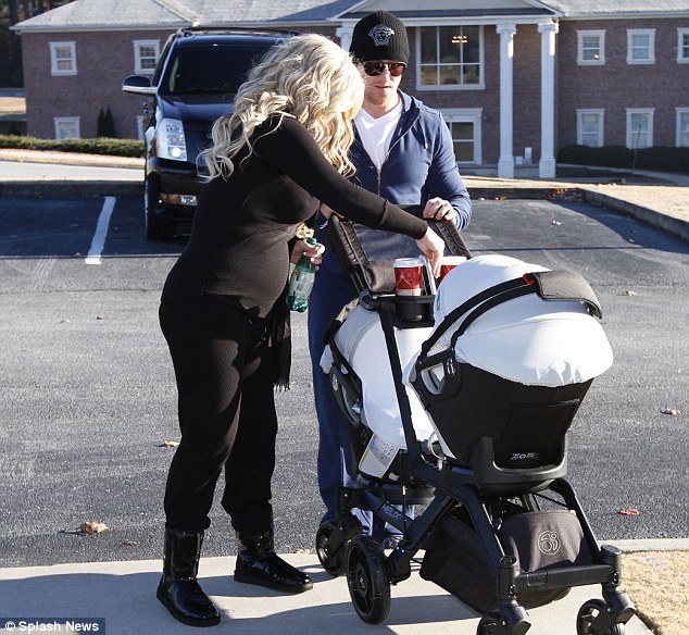 Bouncing back: Kim looked to be in great shape when she was spotted taking a stroll with her newborns, Kaia and Kane, and 28-year-old husband Kroy Biermann on November 29, just four days after giving birth