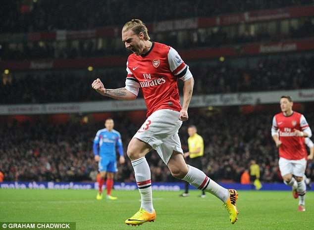 In good Nick: Bendtner wheels away after opening the scoring for Arsenal inside two minutes