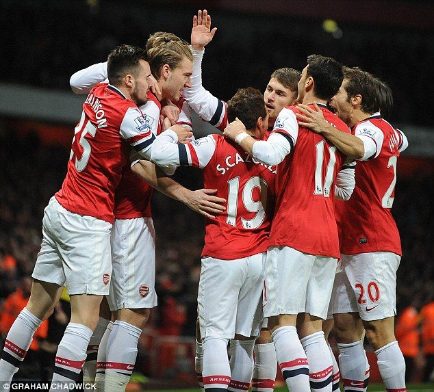 Mobbed: The Danish striker is congratulated by his team-mates