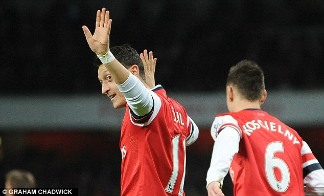 Taking the plaudits: The German playmaker salutes the crowd after doubling Arsenal's lead