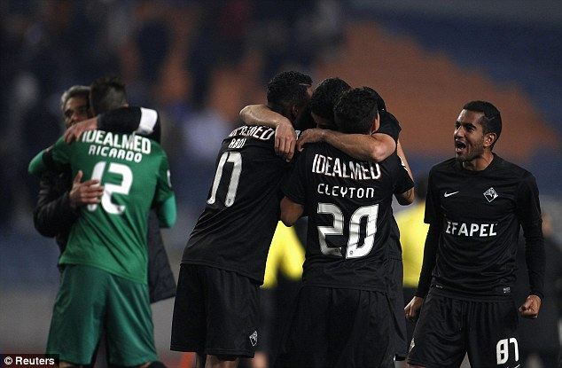 Dreamland: Academica players celebrate their victory over the Portuguese giants