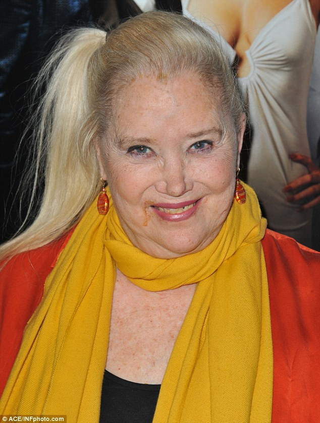 Not red carpet ready: Actress Sally Kirkland forgot to wipe her mouth before stepping out to a special screening of American Hustle on Tuesday in LA