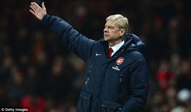 Caution: Arsene Wenger refuses to write off Manchester United in the title race