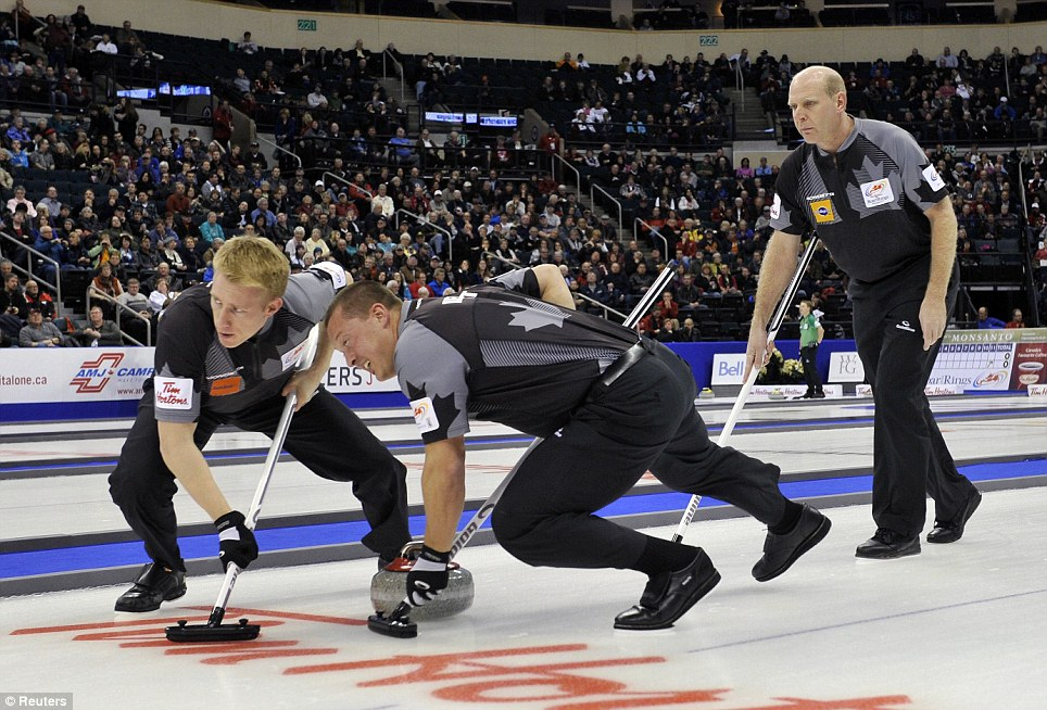 Skip Kevin Martin follows his sweepers second Marc Kennedy (left) and lead Ben Hebert at the Roar of the Rings Canadian Olympic Curling Trials in Winnipeg