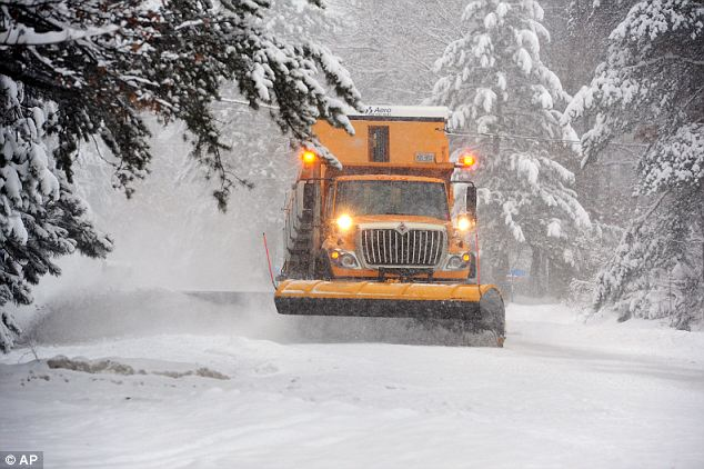 Just the half of it: A Crow Wing County snowplow operator clears snow near Merrifield, Minnesota, a state especially hard hit by Cleon's icy wrath