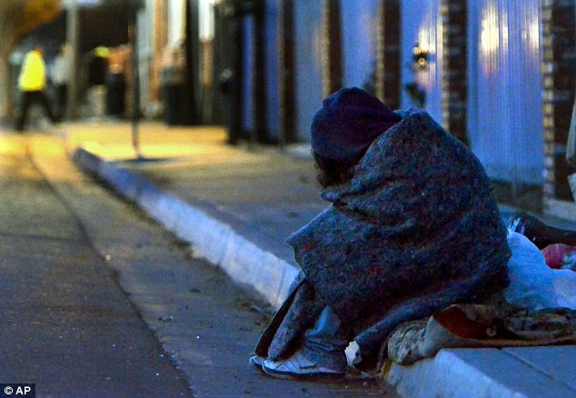 Record chills: A homeless woman tries to ward off the cold near the Fresno Rescue Mission on Wednesday. California's Central Valley has seen record low temperatures as a result of Cleon's fury