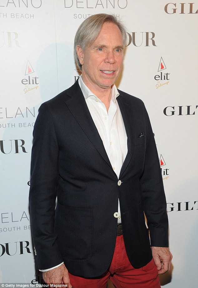 Keeping it casual: Designer Tommy Hilfiger sported a simple, classic look with his blue blazer and red trousers