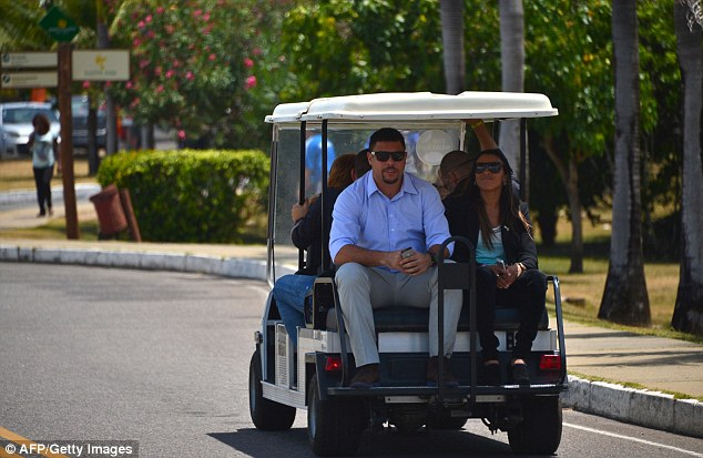 Wheeled out: Brazilian stars Ronaldo and Marta are escorted around the grounds in Costa do Sauipe