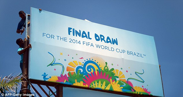 Under construction: Workers put the finishing touch to temporary installations on the eve of the World Cup draw