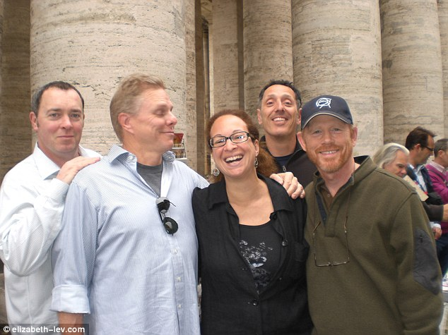In good company: Lev, center, is pictured with director Ron Howard (right) and his film crew during the shooting of 'Angels and Demons' in Rome