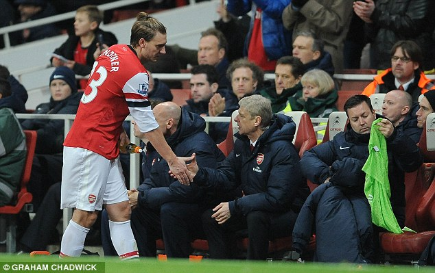 Keeping the faith: Wenger insists Bendtner has all the attributes to become a top player