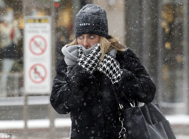 Cleo's wrath: A woman braces against the cold and blowing snow on Denver's 16th Street Mall on Wednesday
