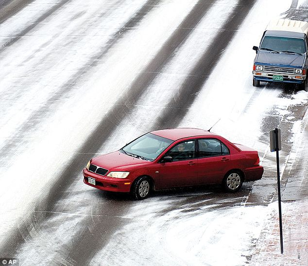 Spun out: A driver makes their way down Sixth Street in downtown Pueblo, Colorado on Wednesday