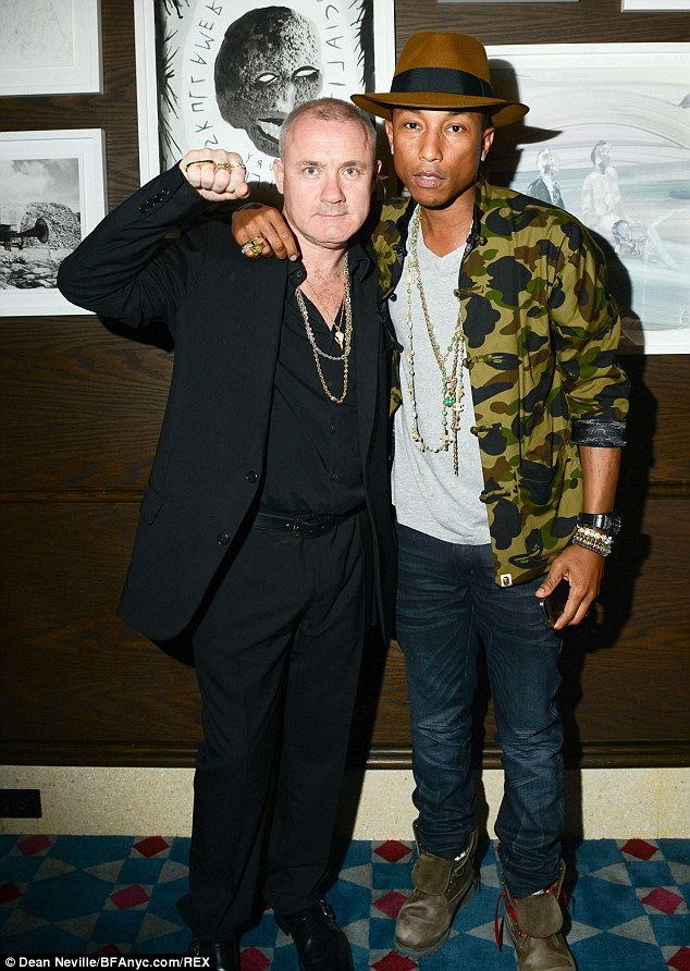 Art attack: Damien Hirst and Pharrell Williams pose for photographs as they gather to celebrate Tracey Emin