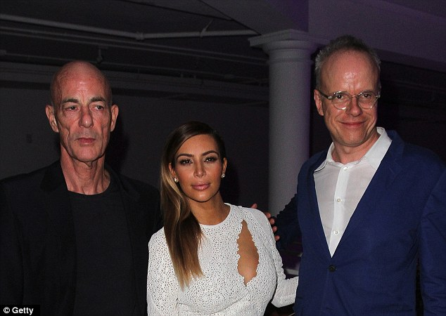 Smouldering: Jacques Herzog and Hans Ulrich pose with a sunning Kim Kardashian