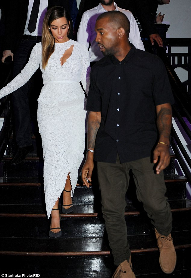 Leading the way: Kanye takes the lead as he and Kim make their way into the Surface event