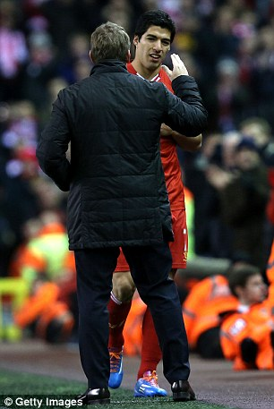 Luis Suarez is congratulated by Brendan Rodgers
