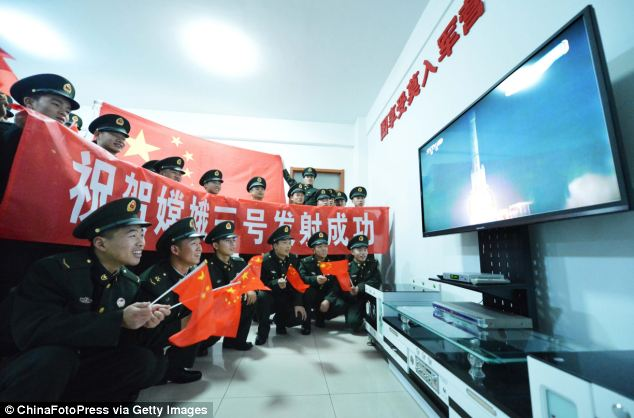 Here, soldiers watch the live broadcast of the lift-off